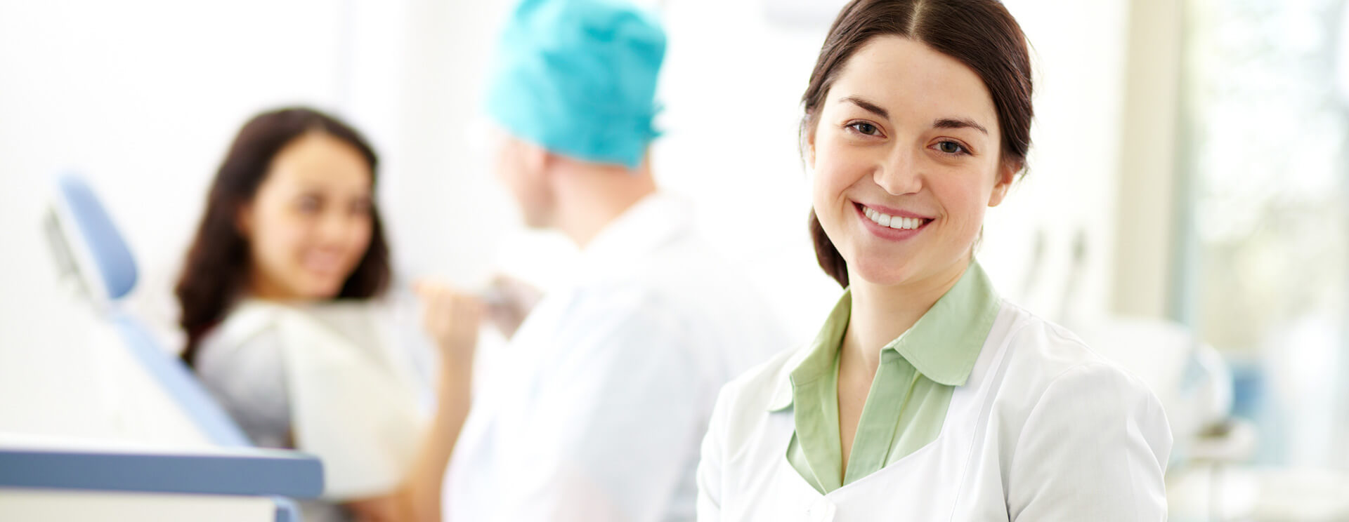 Happy dental assistant smiling at the camera